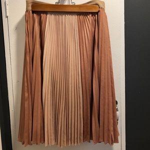 Pleated mid-length rose/tan BCBG skirt.